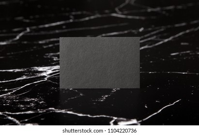 Photo of black business cards on marble. Template for branding identity isolated on marble background. For graphic designers presentations and portfolios marble premium luxury mock-up.