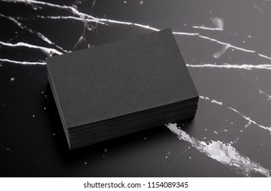 Photo of black business cards on black marble. Template for branding identity isolated on marble background. For graphic designers presentations and portfolios marble premium luxury mock-up.