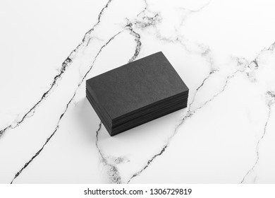 Photo of black business cards on white marble. Template for branding identity isolated on marble background. For  presentations and portfolios marble premium luxury mock-up. Business Card isolated