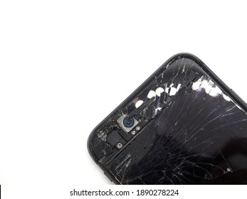 Photo of black cellphone with broken damaged display and front camera. Modern smartphone with damaged glass screen on white background. Device needs repair.