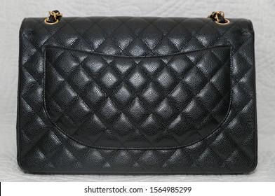 Photo of black classic handbag closeup - Image