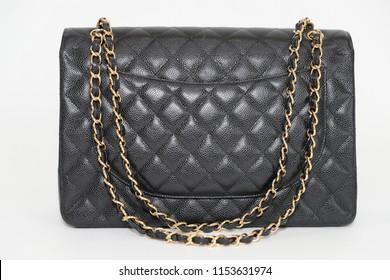 Photo of black leather bag  on white background.
