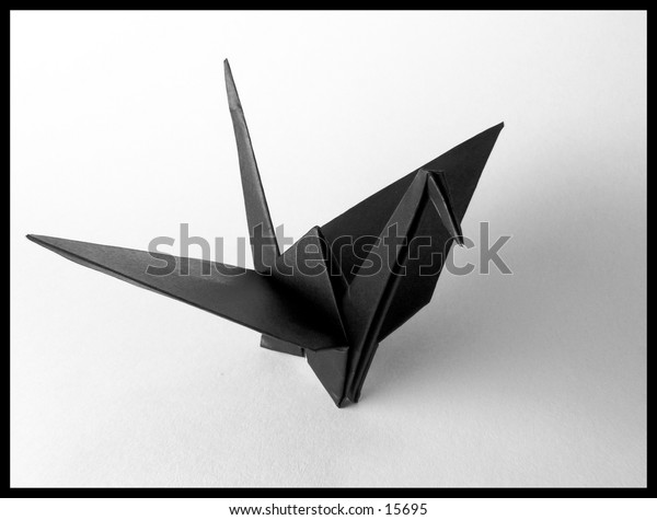 a photo of a black origami crane with a black border