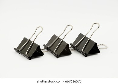 Photo of black paper clip isolated on a white background