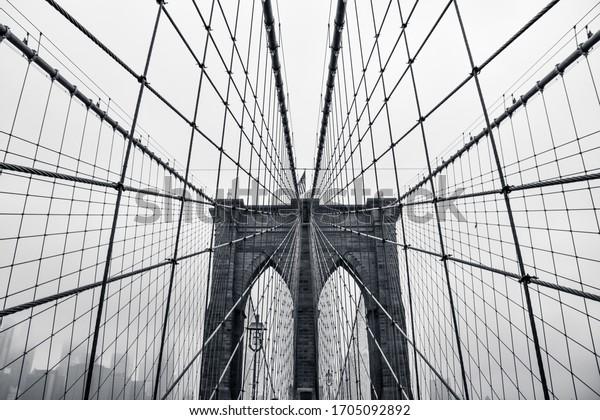 Photo in black and white of the Brooklyn Bridge