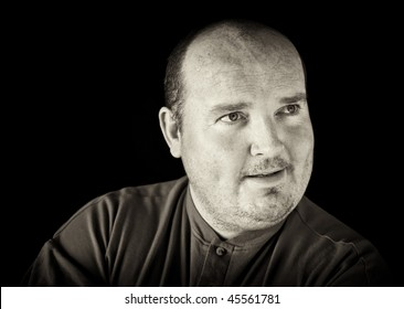 photo black and white of a male in his 30's overweight