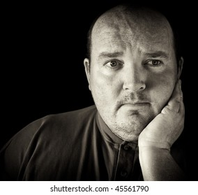 photo black and white of a man aged depressed sad headache