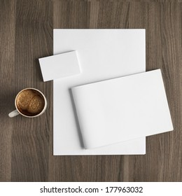 Photo blank a4 sheet, brochure and stack of b-cards with cape of coffee on a wooden texture