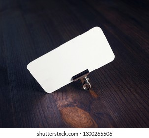 Photo of blank business card on wooden background. Template for ID.