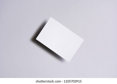 Photo of blank business cards on white. Mock-up for branding identity. For graphic designers presentations and portfolios