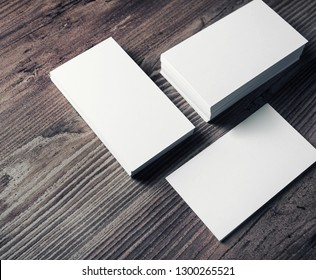 Photo of blank business cards on wooden background. Template for ID.