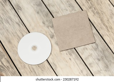 Photo blank. Compact disk and cover on a old wooden texture