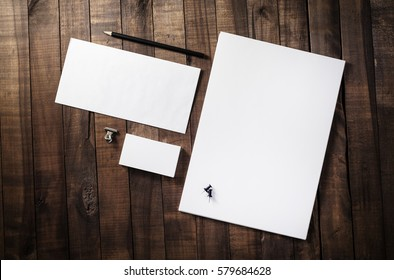 Photo of blank corporate identity. Stationery set. Branding mockup. Sheets of paper, letterhead, business cards, envelope and pencil.