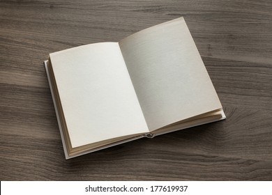 Photo blank open book on textured wood background