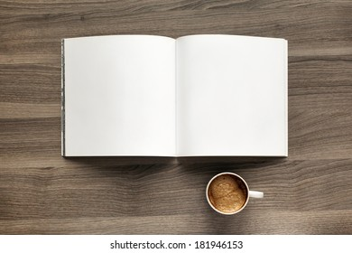 Photo blank. Open square format brochure on a wooden table and coffee
