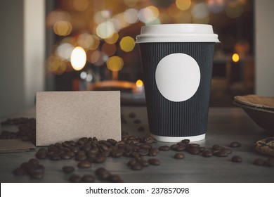 Photo blank paper cup of coffee and business card coffee shop to apply logo