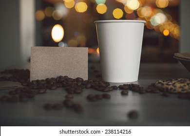 Photo blank paper cup of coffee and business card coffee shop for the application logo
