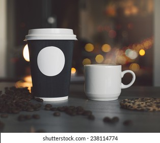 Photo blank paper cup and mugs in a coffee shop to apply logo