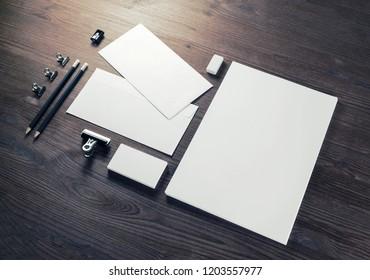 Photo of blank stationery set on wood background. Corporate identity template. Responsive design mockup.