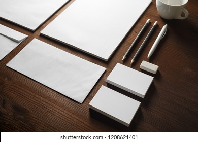 Photo of blank stationery set on wood table background. Corporate identity mock up for placing your design.