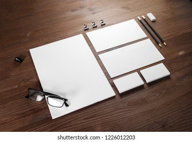 Photo of blank stationery set on wood background. Corporate identity template.