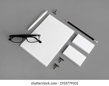 Photo of blank stationery set on gray paper background. Corporate identity mock up for placing your design.