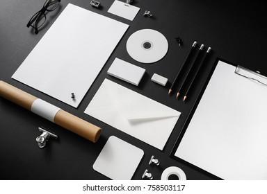 Photo of blank stationery set on black paper background. Corporate identity mockup. Responsive design template.