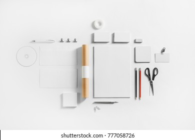 Photo of blank stationery set on white paper background. Corporate identity template. Responsive design mockup. Top view. Flat lay.