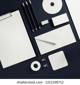 Photo of blank stationery template on black paper background. Responsive design mock up. Flat lay.