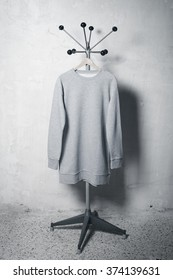 Photo of blank sweatshirt hanging on the hanger. Vertical