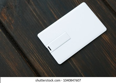 Photo of blank usb flash card cards. Blank usb flash card on wooden table background. Template for ID. Mockup for branding identity.