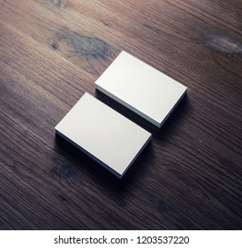 Photo of blank white business cards on wooden background. Template for ID. Top view.