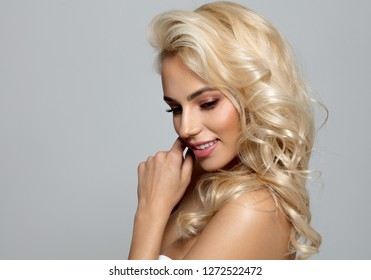 Photo of blond female model looking down