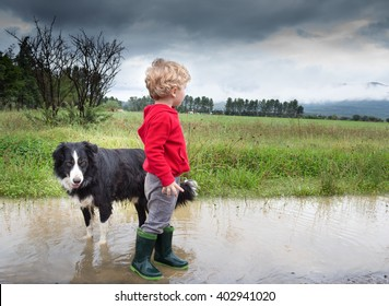 Photo of a blonde boy and his dog after the rain