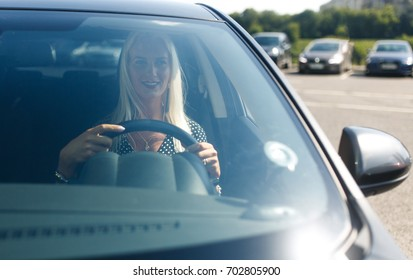 Photo of blonde driving car
