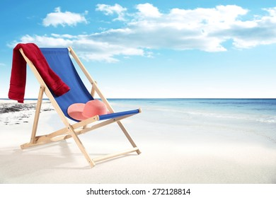 photo of blue chair and red towel on beach