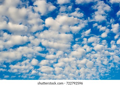 Photo of blue sky with spindrift clouds background