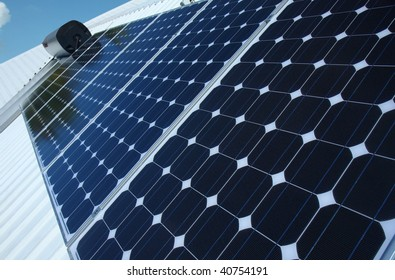 photo of blue solar panels on a roof
