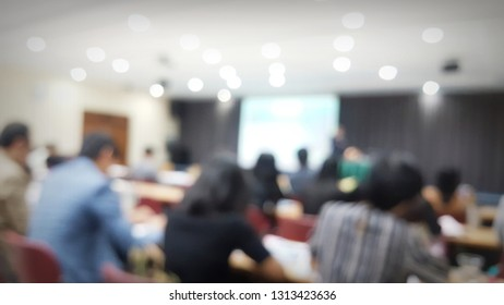 Photo blur, seminar room with many attendees