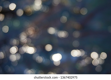 the photo with the blur technique is suitable for use as a background concept. Abstract texture. Colorful. Defocused Blurred bright light. Circular round points.