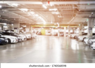 photo blurred car parking lot indoors square row on the side of the building. Leave space empty for write text.