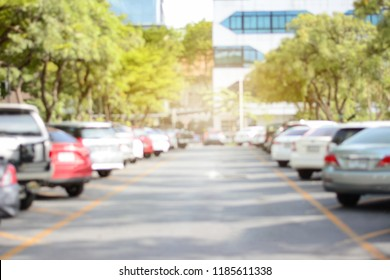 Photo of blurred parking cars in the city and copy space.