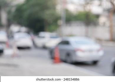 Photo of blurred parking cars in the city