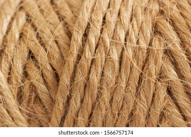 Photo bobbin with thread, rope close-up for texture or background design.