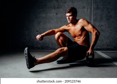 Photo of a bodybuilder during a training with a kettlebell