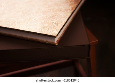 Photo book with a cover of genuine leather. Brown color with decorative stamping . Soft focus.