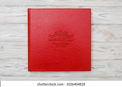 Photo book with embossing. Red photo book with  leather cover. Photo album with a hard cover Bright red photoalbum. background for photo publishing