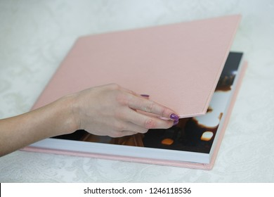 photo book with  leather cover unfolded photobook photo book opened sample photobook the person is looking at a photobook