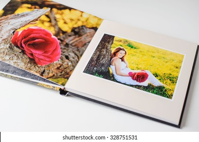 Photo book of young couple, pregnancy and expectation.