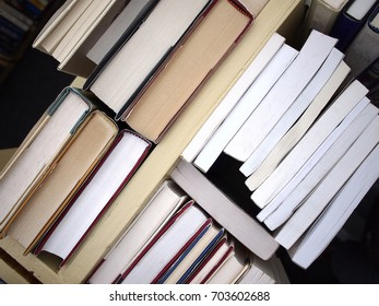 Photo of books arranged on a bookshelf